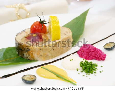 Stuffed fish with lettuce leaves