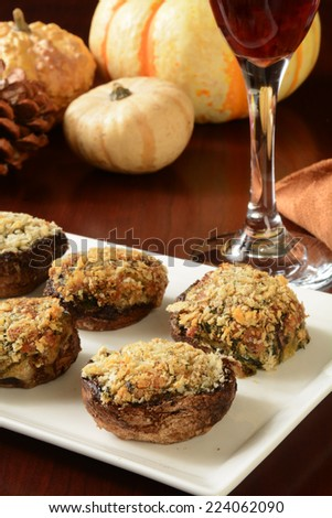Stuffed mushrooms with spinach, mozzarella, parmesan and fontina cheeses - stock photo
