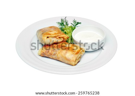 Stuffed Pancakes with cottage cheese with sour cream sauce isolated on white background