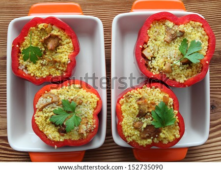 Stuffed paprika with meat, pearl cous cous and mushrooms - stock photo