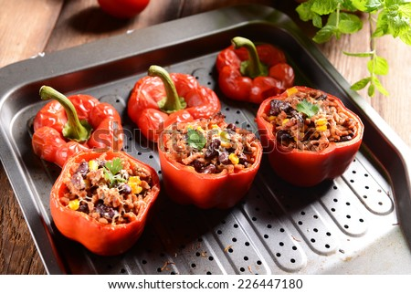 Stuffed peppers with meat, kidney beans and corn - stock photo