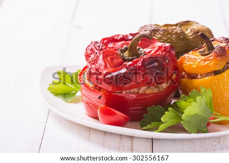 Stuffed peppers with meat , rice and vegetables.