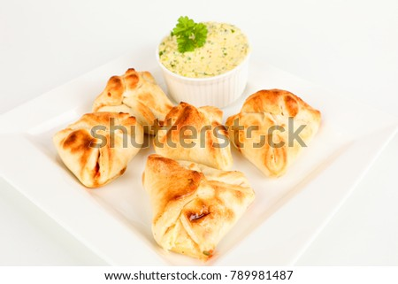 stuffed pizza rolls with herb butter on a plate