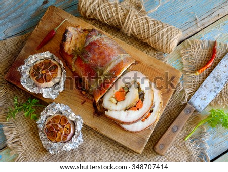 Stuffed Pork Loin Roast with baked garlic - stock photo