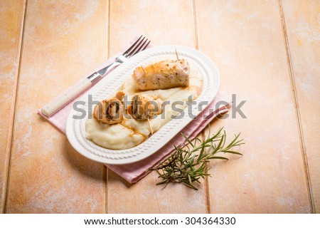 stuffed roll with porridge - stock photo