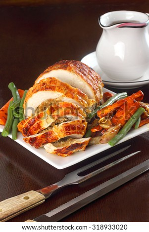 Stuffed turkey breast for Thanksgiving or Christmas dinner - stock photo