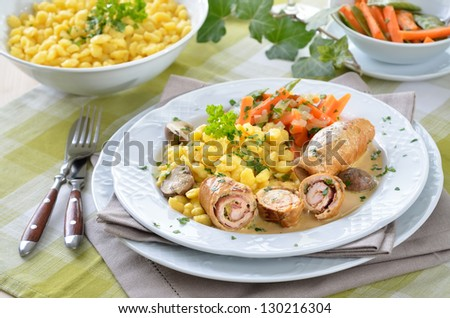 Stuffed turkey rolls with ham and spring onions in mustard sauce