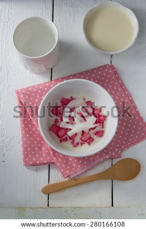 Stuffed Water Chestnut in Syrup and Coconut Milk served with Crushed Ice, Thai Cuisine - stock photo