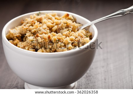 Stuffing in a white bowl on wood background - stock photo