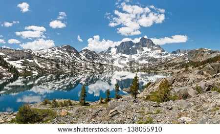 Stunning Alpine Lake Scenery. Banner Peak towering above Garnet Lake in the Ansel Adams Wilderness, Sierra Nevada, California, USA. - stock photo