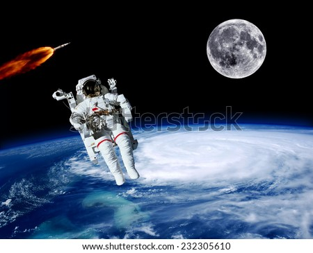 Stunning astronaut spaceman moon Earth rocket space. Elements of this image furnished by NASA.