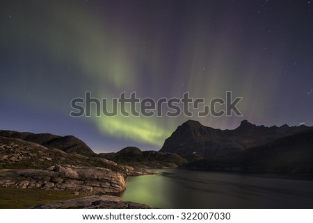 stunning aurora borealis captured in norway in mountain landscape - stock photo