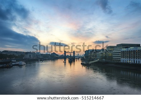 Stunning Autumn Fall sunrise over Tower Bridge and River Thames in London.