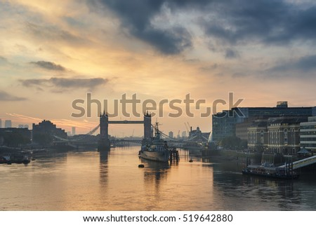 Stunning Autumn sunrise over River Thames and Tower Bridge in London
