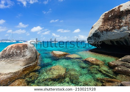 Stunning beach with white sand, unique huge granite boulders, turquoise ocean water and blue sky at Virgin Gorda, British Virgin Islands in Caribbean - stock photo