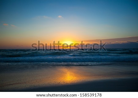 Stunning beautiful sunset on an exotic beach in Mexico - stock photo