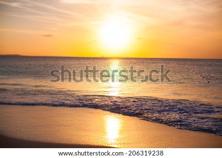 Stunning beautiful sunset on an exotic caribbean beach