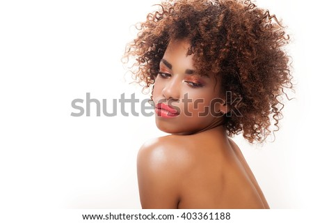 Stunning beautiful young african american black woman. Beauty portrait. Afro hairstyle. Glamour makeup. White background. Studio shot. - stock photo