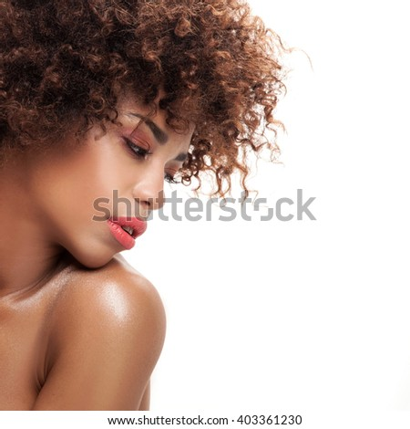 Stunning beautiful young african american black woman. Beauty portrait. Afro hairstyle. Glamour makeup. White background. Studio shot.