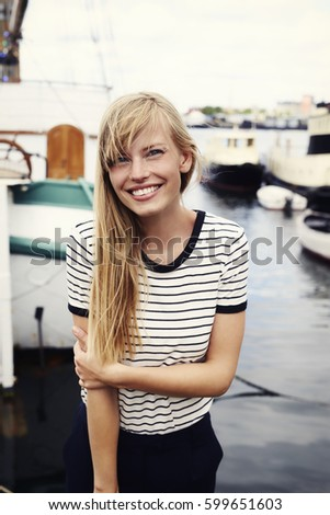 Stunning blond woman smiling at camera