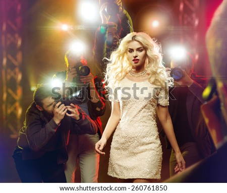 Stunning blonde beauty and press photographers - stock photo