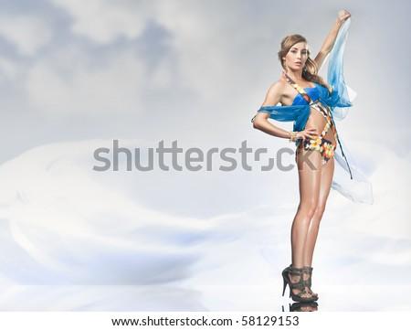 Stunning blonde posing over sky background - stock photo