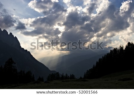 Stunning cloud formation with sun rays falling on valley in the Alps, Tyrol, Austria.