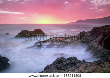 Stunning colours dominate the skyline as the sun dips below the horizon at Shelter Cove which lies on Californias Lost Coast where the King Range meets the Pacific Ocean. - stock photo