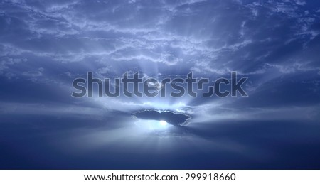 Stunning dawn with sun through the clouds - stock photo