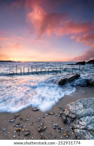 Stunning dramatic sunrise at Little Fistral beach a small cove off the main Fistral beach at Newquay in Cornwall - stock photo