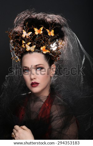 Stunning Fashionable Woman Wearing High End Head Piece