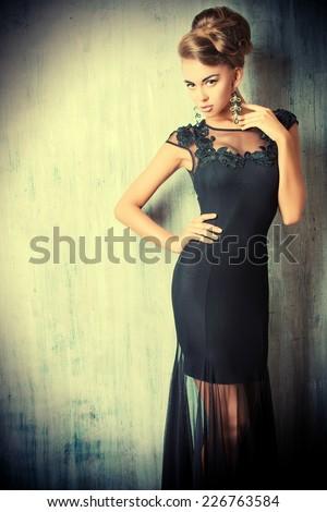 Stunning female model in black evening dress. Fashion shot. - stock photo