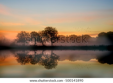 Stunning foggy Autumn  sunrise English countryside landscape image