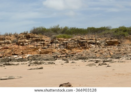 Stunning Gantheaume Point,  a red-sandstone headland that juts out into the Indian Ocean from beautiful Cable Beach, Broome, North Western Australia is a popular tourist spot with dinosaur footprints.