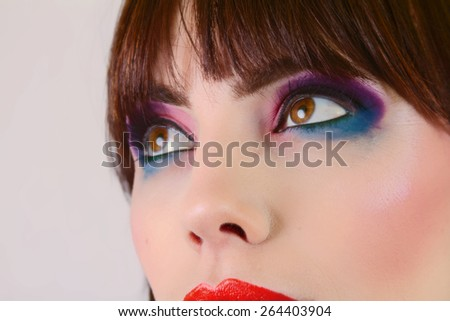 Stunning Girl with Colorful Makeup - stock photo