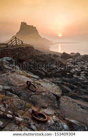 Stunning Landscape Dawn of Lindisfarne Castle Holy Island Northumberland England/ Lindisfarne Dawn. - stock photo