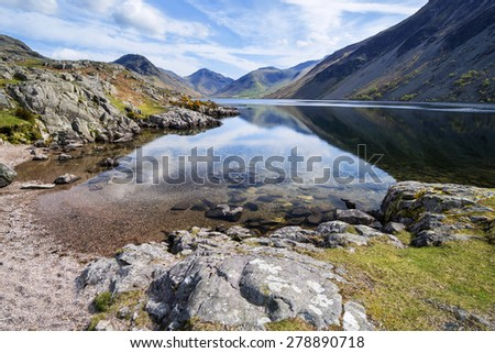 Stunning landscape of Wast Water with mountains reflected in calm lake water in Lake District - stock photo