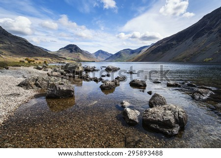 Stunning landscape of Wast Water with mountains reflected in calm lake water in Lake District
