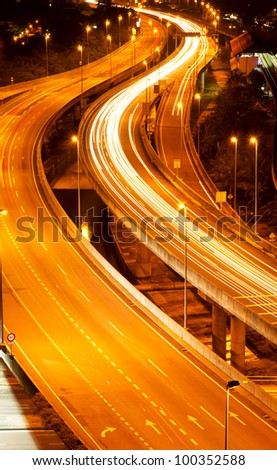 Stunning light trail from the busy highway traffic. - stock photo