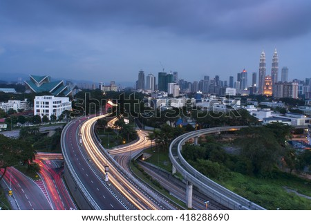 Stunning light trail scenery at the busy highway in Kuala Lumpur city in the morning  - stock photo