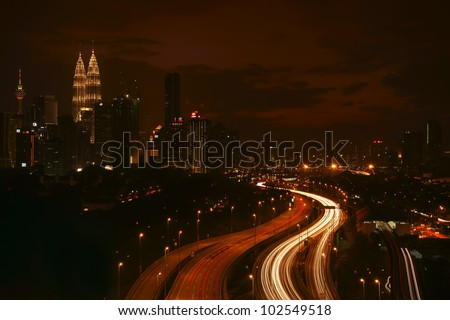 Stunning light trail scenery in Kuala Lumpur city at night - stock photo