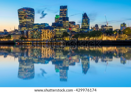 Stunning London cityscape after sunset with its reflection from river Thames - stock photo