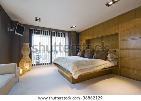 Stunning Luxury Bedroom With A King Size Bed, Wall Mount Plasma Tv, Sofa .