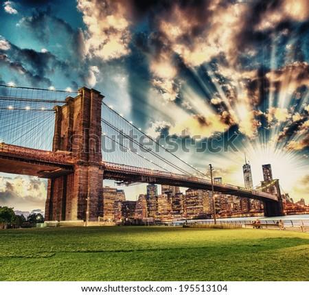Stunning night skyline of Manhattan from Brooklyn Bridge Park - stock photo
