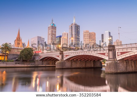 Stunning night skyline of Melbourne with river reflections. - stock photo