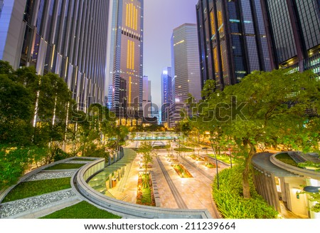 Stunning night view of modern city skyline with park and gardens. - stock photo