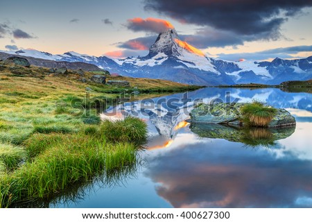 Stunning panorama with Matterhorn at morning sunrise and beautiful alpine lake,Stellisee,Valais region,Switzerland,Europe