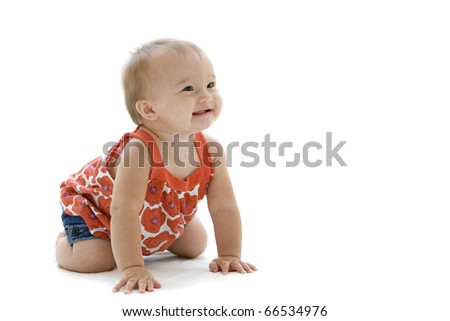 Stunning portrait of a baby girl crawling - stock photo