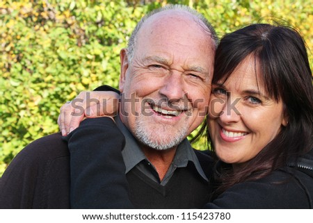 Stunning portrait of a senior father and his daughter - stock photo