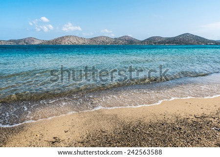 stunning seascape and mountain view at Elounda beach in Crete, Greece - stock photo
